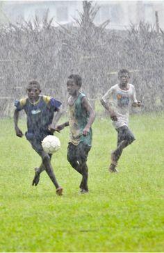 Some kids playing soccer in Vanuatu.