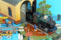 Bing 0 gauge locomotive, turntable and engine shed.