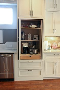 I'm absolutely in love with this kitchen remodel, esp the custom cabinet for appliances!!