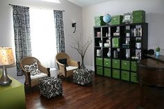I like the idea here of the pop color...Love this Green, Black and white room!