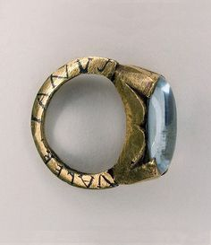 Gold wedding-ring set with a stone of aquamarine. The names Valerianus and Paterna are inlaid in niello around the edges of the ring. 3rd Century Roman. Found at Beaurains (British Museum)