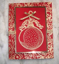 Christmas card...luv the red card with lots of gold embossing, ribbon & backing paper... Christmas ornament....like the layout design...