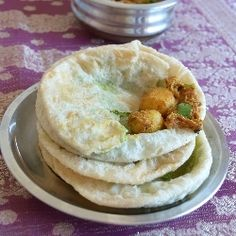 Indian flat bread stuffed with green peas and deep fried and is served with baby potatoes in spicy yogurt gravy- A Bengali delicacy