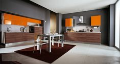 black and orange kitchen design with dining table and rug – Mobalpa orange kitchens