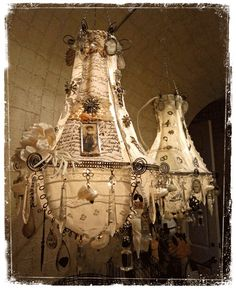 Chandeliers--- looks to me as if you could upcycle all kinds of things onto these lights!