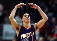 Devin Booker Photos Photos - Devin Booker #1 of the Phoenix Suns celebrates a win over the Chicago Bulls at the United Center on December 7, 2015 in Chicago, Illinois. The Suns defeated the Bulls 103-101. NOTE TO USER: User expressly acknowledges and agrees that, by downloading and or using the photograph, User is consenting to the terms and conditions of the Getty Images License Agreement. - Phoenix Suns v Chicago Bulls