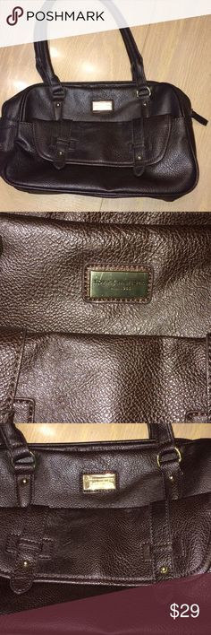 """Tommy Hilfiger purse Nice Brown faux leather purse  front outside pocket that is length of purse. Large inside compartment with small zippered compartment and 2 small open compartments inside. 11 3/4 x 8"""". Barely used   One small scratch on Tommy Bahamas's tag. Only noticeable close up at angle. See pics Tommy Hilfiger Bags"""