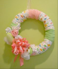 Baby Shower Wreath: lil socks are the flowers; cld use diapers, bibs, burp cloths etc to cover the straw wreath