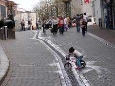 Water feature in Stikke Hezelstraat, city center of Nijmegen, the Netherlands.