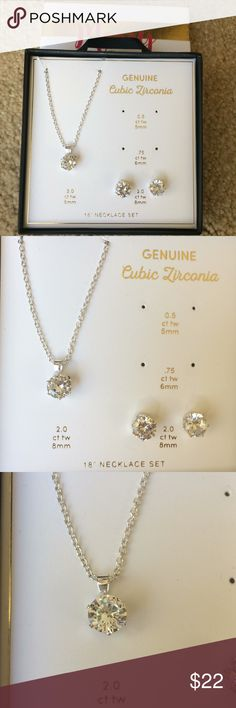 Diamond Necklace and Earring Set Brand new, in box cubic zirconia diamond and silver necklace and earring set. Necklace and earrings are 2.0 ct wt (8mm). The .5 and .75 ct wt earrings are not available. Blue Door Boutique Jewelry Necklaces