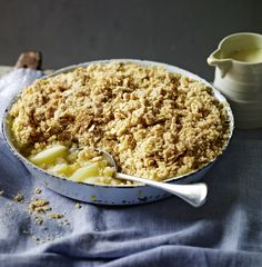 Apple crumble with tart Bramley apples and a topping made extra crunchy by demerara sugar and oats