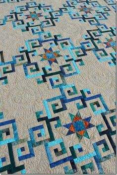 """I am thunderstruck. So beautiful quilt on a long-arm quilter's page. She says piecing design is the """"pattern which is called Aegean Sea and it can be found in the book Stellar Quilts by Judy Martin."""" Be sure to go to this page and see all of the photos!"""