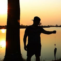 Caught a fish as the sun went down( no worries it was released back into the water)  Mudumo National Park Kwando  Image: Olaf Beiter