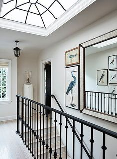 "The skylight on the upstairs landing brings in lots of California light. ""It adds drama and height to the space,"" says Mark. Custom wrought-iron railings echo the window's design. The bird prints are inspired by his friend Bunny Williams's home in the Dom Rellano, Mark Sikes, Upstairs Landing, Bedroom Red, Entry Hallway, Love Home, Stairways, Interior Inspiration, Living Spaces"