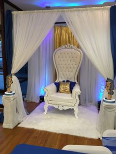 Canopy for mom to be area. Throne chair with white rug, pedestals and baby foam Pharaoh custom pieces