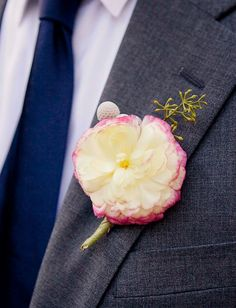 Tie-dyed peach peonies were a sweet, simple touch as boutonnieres at this @Four Seasons Resort and Club Dallas at Las Colinas wedding.