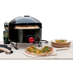 After pitching the tent ,and before s'mores around the campfire, enjoy homemade pizza in the glory of the outdoors with this portable propane gas outdoor pizza oven. Perfect for tailgating, too.