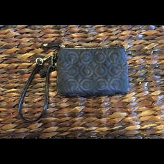 Coach signature wristlet Like new authentic coach wristlet.  Quilted signature design exterior, beautiful purple interior.  Purchased at Nordstrom.  Used maybe once or twice.  Feel free to make an offer if interested! ☺️ Coach Bags Clutches & Wristlets
