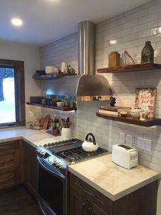 Live edge open shelves, McIntyre brick tile, Taj Mahal quartzite, Lake Tahoe Kitchen, Josh Roberts Construction