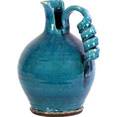 Tessa Vase. Distinctive spiral handle and asymmetrical spout. Me likey.