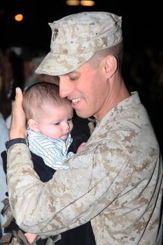 Lance Cpl. Gorge Rodriguez, an intelligence specialist with 2nd Battalion, 4th Marine Regiment holds his son William for the first time at the San Mateo parade deck, March 27. Rodriguez along with more than 300 other Marines and sailors returned from a seven-month deployment to Helmand province, Afghanistan.    Read more: http://www.dvidshub.net/news/85838/marines-families-overjoyed-homecoming#.T39TXhw4ioo#ixzz1rIKJ1GtU