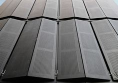 EQUITONe facade panels. Perforated window shutters. #architecture #material #facade #perforated www.equitone.com