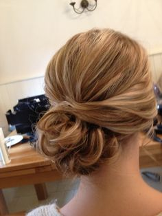 wedding hair side bun | Side bun chignons are also a great look and this bridesmaid looked fab ...