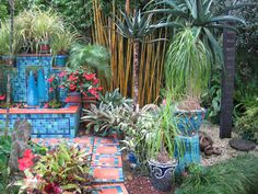 Kevin Kilsby's garden in Auckland, New Zealand, is one of my favourites. Kevin is a ceramic artist and has made the tiles and pots that decorate his colourful garden. Details if you want to visit are here: www.kilsby.co.nz/mygarden.htm Photo by Colour Happy / Adele Garden Pool, Garden Art, Home And Garden, Colorful Garden, Ceramic Artists, Outdoor Spaces, Greenery, Mosaic, Sculpture