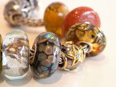 very rich Trollbead colors with gold
