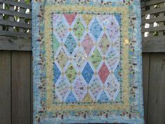 MADE TO ORDER Beautiful patchwork baby quilt featuring your favourite Beatrix Potter characters - Peter Rabbit, Tom Kitten, Jemima Puddleduck, Mrs Rabbit, Benjamin Bunny, Pigling Bland and more, all featured in diamond shaped blocks with a Peter Rabbit outer border. This is the perfect