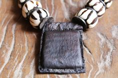 Old Tuareg tribe leather Amulets / talisman.  by Timbuktugallery