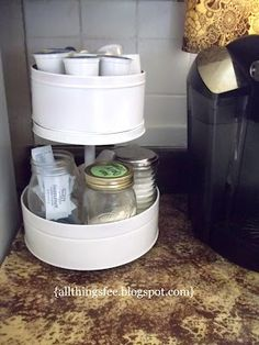 She made this organizer from two tins and an old paper towel dispenser.