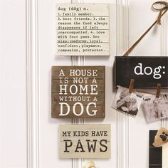 Wood planked signs feature pet sayings.
