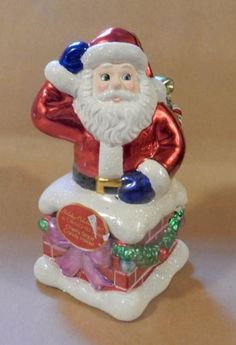 I wish I bought more od these when I had the chance,,,,in 2004 :(Christopher-Radko-Unopened-Christmas-Candy-Container-2004-Santa-in-Chimney-L