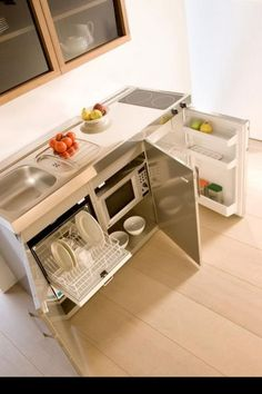 Compact kitchen. Close the cabinet doors and get a clean look. See food, eat food, so I can hide my kitchen.