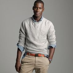 Love the sweatshirt over collared shirt + belt + flat front kahki's. Just hot.