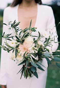 Brides.com: . This wild bouquet — created by Hattie Fox at That Flower Shop — is comprised of sage with accents of pale pink and ivory, thanks to dahlias and garden roses.