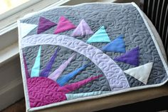 Take a look at your next quilting project with new eyes. It's time to try some new free-motion quilting designs. These six go-to patterns are beautiful, yet so simple that even beginners will have no trouble implementing them into their quilts.