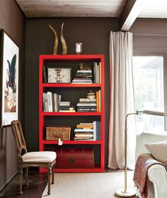 I'm going to the paint the entertainment center red in the kids room downstairs...with brown walls and brown couch....