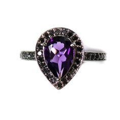 Amethyst pear and black diamond halo black gold ring Perfect, but make those diamonds normal!