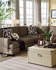 Natural tones in a coastal living room with brown accents