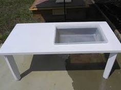 Genius idea for a diy sensory table. Cut out space for a bucket and cut off the legs to make it shorter.