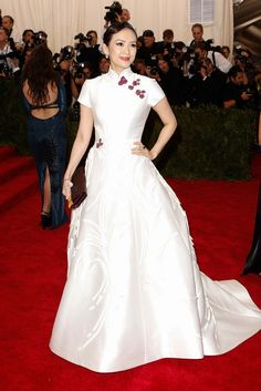 2015 Met Gala: Red Carpet Arrivals - Zhang Ziyi in a Carolina Herrera dress and Cindy Chao jewelry (as embellishments on her dress)
