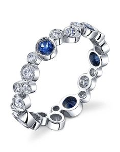 "Erica Courtney presents Platinum ""Champagne Bubble"" Band, accented with 0.70ctw diamonds and 0.50ctw sapphires."