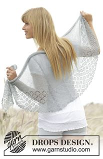 "Falling in Lace - Knitted DROPS shawl in stocking st with edge with lace pattern and ridges in ""Lace"". - Free pattern by DROPS Design"