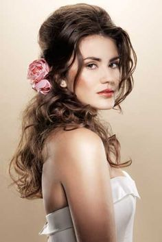 loose natural slightly pulled back hair with flower accent