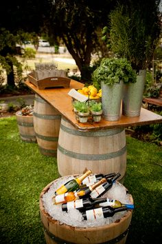 Hire Society's whole wine barrels ($50.00) when placed under a wooden tabletop create the perfect outdoor bar or food table.
