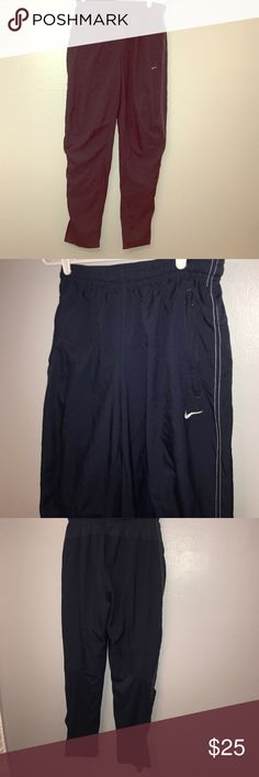 Nike S small workout pants with zipper pockets Zipper pockets and zippers and calls kind of like parachute pants has a net aligning with drawstrings inside these are size S P CH   UK 26/28.  Please see pictures for measurements I do not know if these are men's or women's pants but they were want worn by small woman. These are great for jogging!  These pants are a very dark dark dark black bluish color. They are black but they almost look like they are a dark blue.  (#00201) Nike Pants Track…