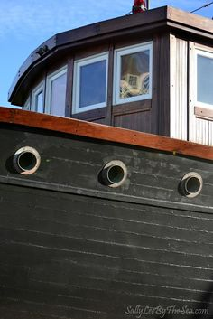 Great portholes, interesting wood building style