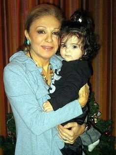 Iran's Empress Farah is very popular.   17000 Facebook likes on this photo of her and her grandaughter.